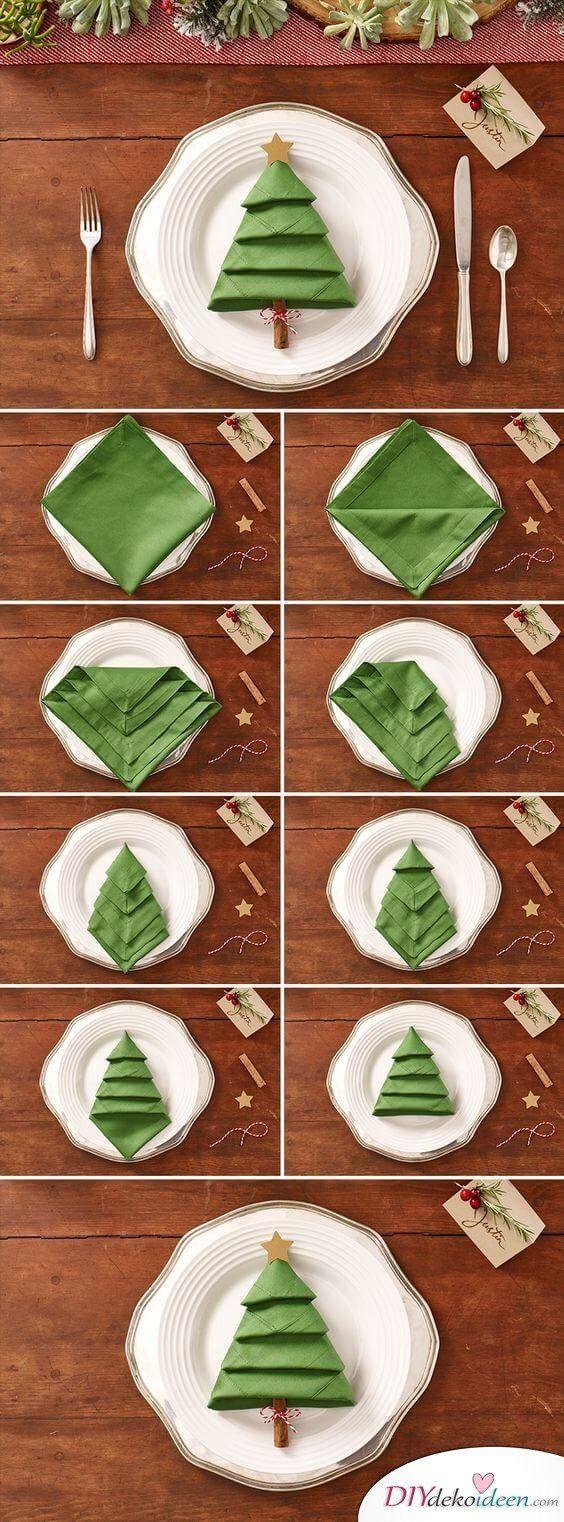 Décoration de table de Noël avec un pliage de serviette en forme de sapin